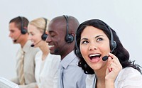 Animated businesswoman and her team working in a call center in the office