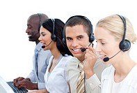 Ambitious business people working in a call center in the office