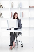 High angle of a young businesswoman working at a computer in the office