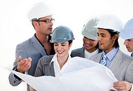 International engineers studying a construction plan against a white background