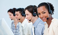 Multi_ethnic business people using headset in a call center
