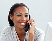 Close_up of a confident businesswoman on phone in the office