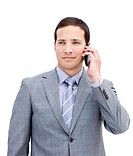 Portrait of an assertive businessman on phone against a white background