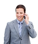 Portrait of a serious businessman on phone against a white background