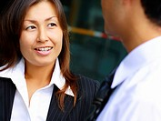 Close_up of a businesswoman with a businessman