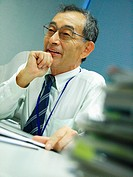Senior man sitting in an office and smiling