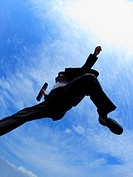 Low angle view of a businessman jumping in mid_air
