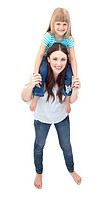 Caucasian brunette mother giving her daughter piggyback ride against a white background
