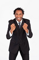 Smiling afro_american businessman with fist looking at the camera