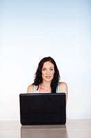 Attractive woman concentrated on her laptop with copy_space