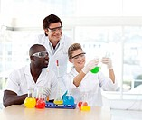 Multi_ethnic scientists examining a test_tube