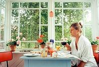 Single woman breakfasting. Sweden