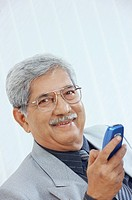 Old man holding mobile phone MR551