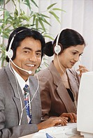 Colleagues using microphones in BPO call centre MR567,568