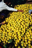 Man selling sweet limes , Pune , Maharashtra , India