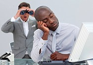 Asleep businessman annoyed by a man looking through binoculars in the office