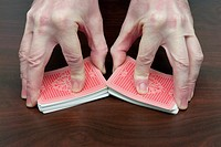 Man Hands Shuffling Cards