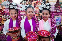 Girls in traditional Thai costume in a flower festival, Chiang Mai, Thailand