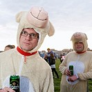 Two men dressed as sheep drinking cans of lager at The Square Music Festival, Borth, Wales UK July 2009