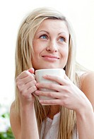 Portrait of a beautiful young woman drinking a coffe in a living_room