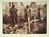 Officers visiting improvised graves at the ruined village Bikschote in Flanders during the First World War, Belgium