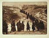 Infantry soldiers marching through the dunes in winter at De Panne in Flanders during the First World War, Belgium