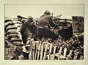 Soldiers in trench shooting with rifle and machine gun in Flanders during the First World War, Belgium