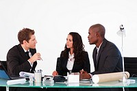 Three young business people discussing in a meeting