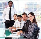 Multi_ethnic business people looking at the camera in a meeting