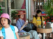 Women enjoying a light meal at a café, Lamma Island, Hong Kong