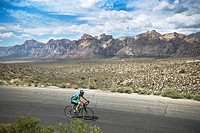 Cyclist rides through Red Rock Canyon State Park outside Las Vegas, NV. USA