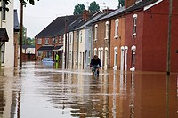 Man Riding Bicycle Through Floods in Gloucester England July 2007
