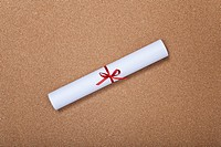 close_up of rolled paper scroll tied