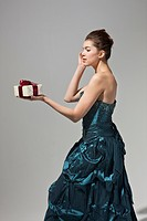 beautiful woman in dress holding gift box