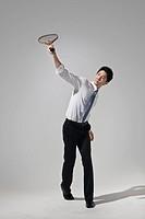 Businessman playing tennis