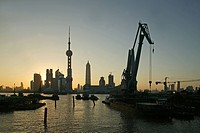 Harbour, View from Waibaidu Bridge, Huangpu_River, Pudong, line of freight barges, man with helmet