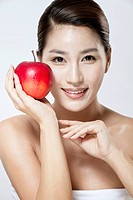 smiling woman holding an red apple