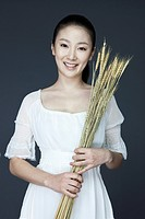 smiling woman holding wheat