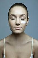 woman with facial cream