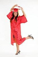 A female caucasian in red graduation gown and very excited  She is on a white background