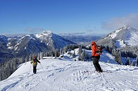 Two skiers downhill skiing on slope, Rosskopf, Spitzing, Bavarian Alps, Bavaria, Germany