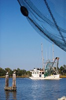 Fishing boat on a branch of the Mississippi river, south of New Orleans, Louisiana, USA