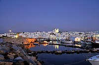 Houses and church at moonrise, Naoussa, island of Paros, the Cyclades, Greece, Europe