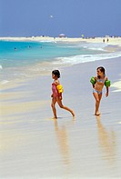 Two girls playing on the beach, Santa Maria, Sal, Cape Verde, Africa