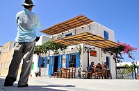People in front of a restaurant in the sunlight, Léfkes, island of Paros, the Cyclades, Greece, Europe