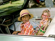 Young boy and girl ready for road trip in convertible