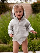 Toddler girl in gray hooded sweatshirt
