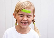Little girl with band aid on forehead