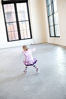 Young girl playing in studio