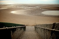 Steps down to empty beach at Blackpool